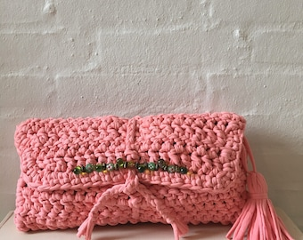 Lovely peach clutch with green glass beads