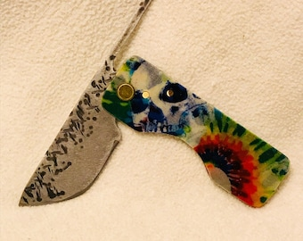 Friction folder Knife with Tie Die Skull Micarta