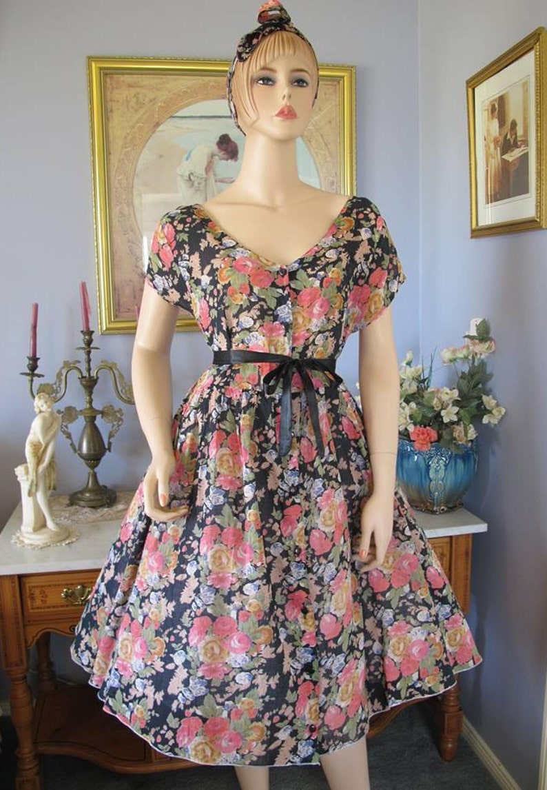 Gorgeous 50s style vintage 90s cotton muslin black floral midi dress with Rosie the Riveter head tie
