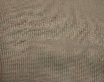 23 Soft sage green corduroy type fabric with very short wales.