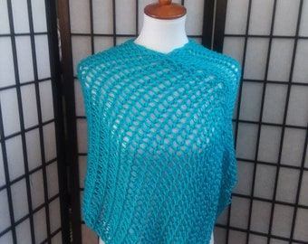 Handmade, knitted Light weight Poncho in teal.
