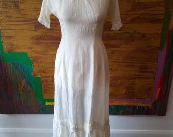 Off white Edwardian silk slip dress with lace trim. Size medium.