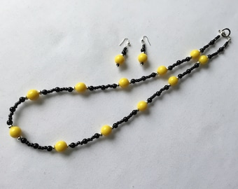 Bright sunshine yellow and black beaded necklace and earring set