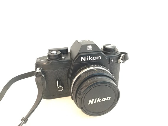 Vintage Nikon Em Slr 35mm Film Camera With Nikon Lens Series E Etsy