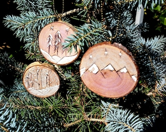 Holiday ornaments, 1 or a set of 3 wood burned designs, live edge birch slices, birch and pine trees, mountains. brass chains, wintry scene