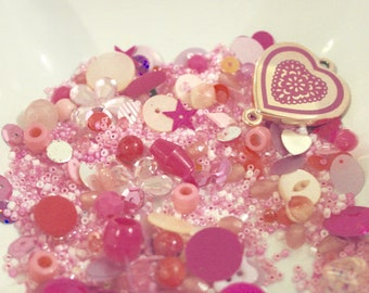 Perfectly pink coloured assorted vintage and retro beads, buttons and sequins