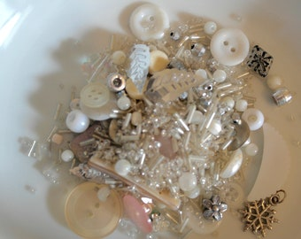 Assorted vintage silver, white and cream coloured beads, buttons and sequins.