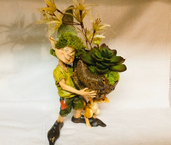 Forest Fairy with Rabbit carrying a dried nut pod with Faux Succulent Plant laying in soft reindeer Moss Free Domestic Shipping