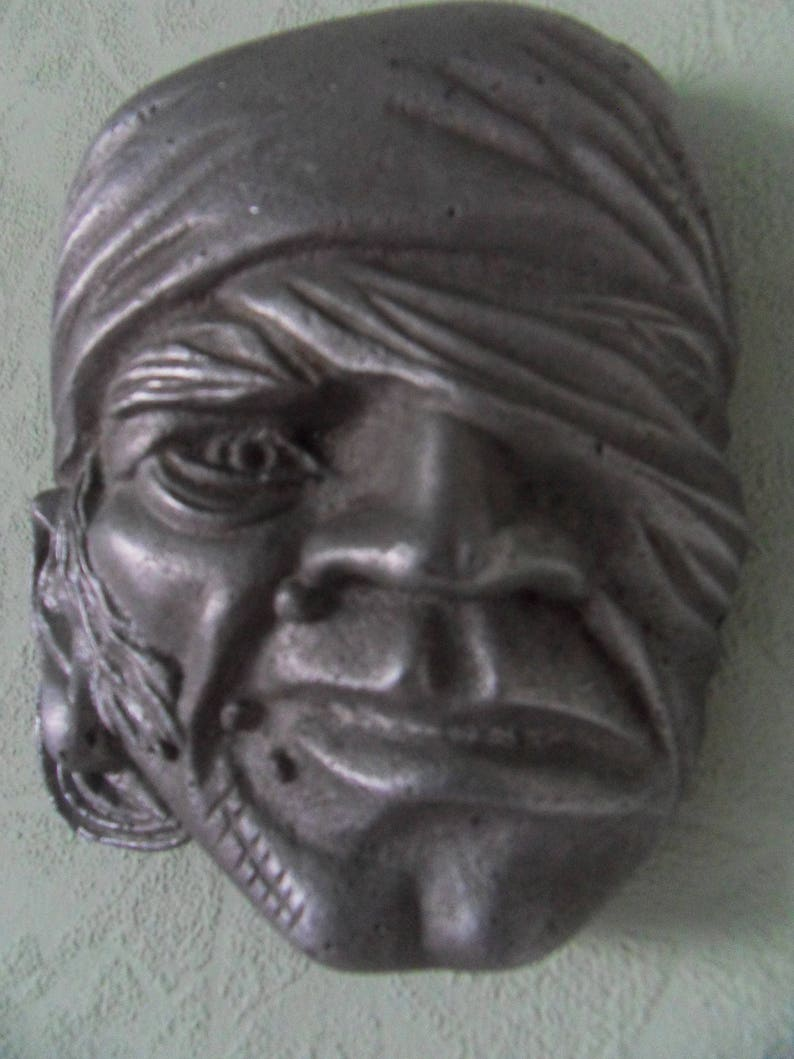 Vintage bas-relief from cast aluminum, one-eyed pirate, artistic casting of  the USSR period
