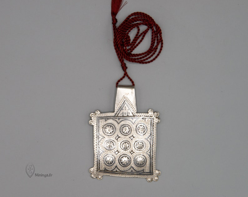 Antique silver pendant from Morocco with a minimalist silk rope
