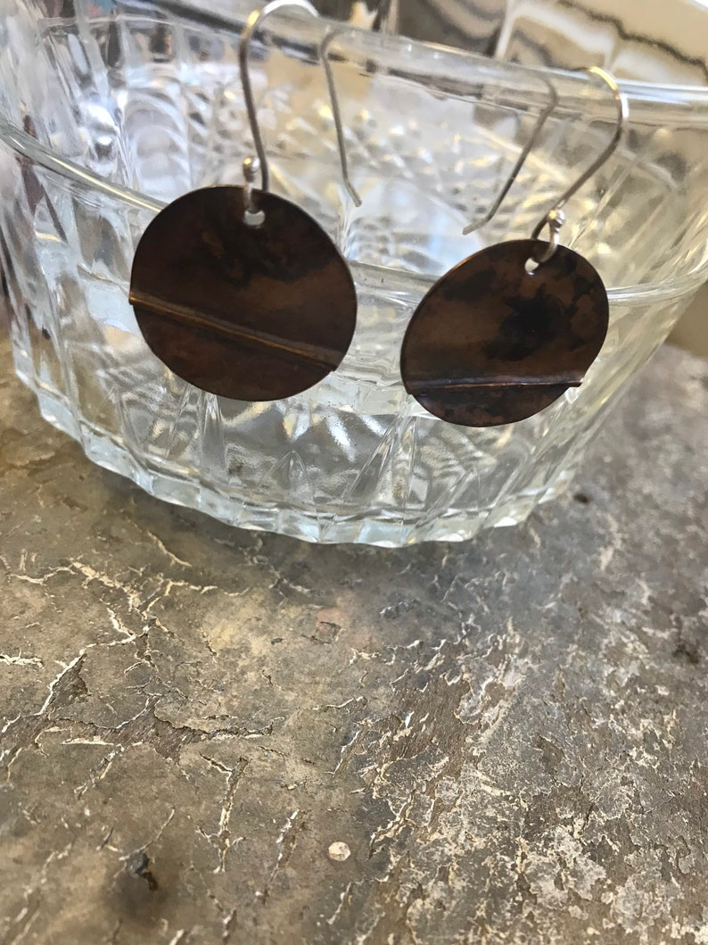 Dark brown copper textured copper earrings.