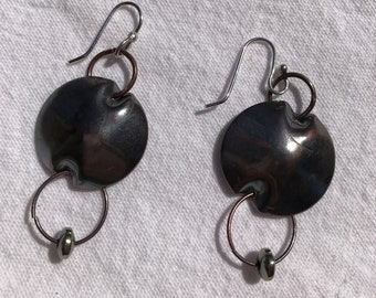 Handmade oxidized copper earrings with an additional drop of a bead in orbit.