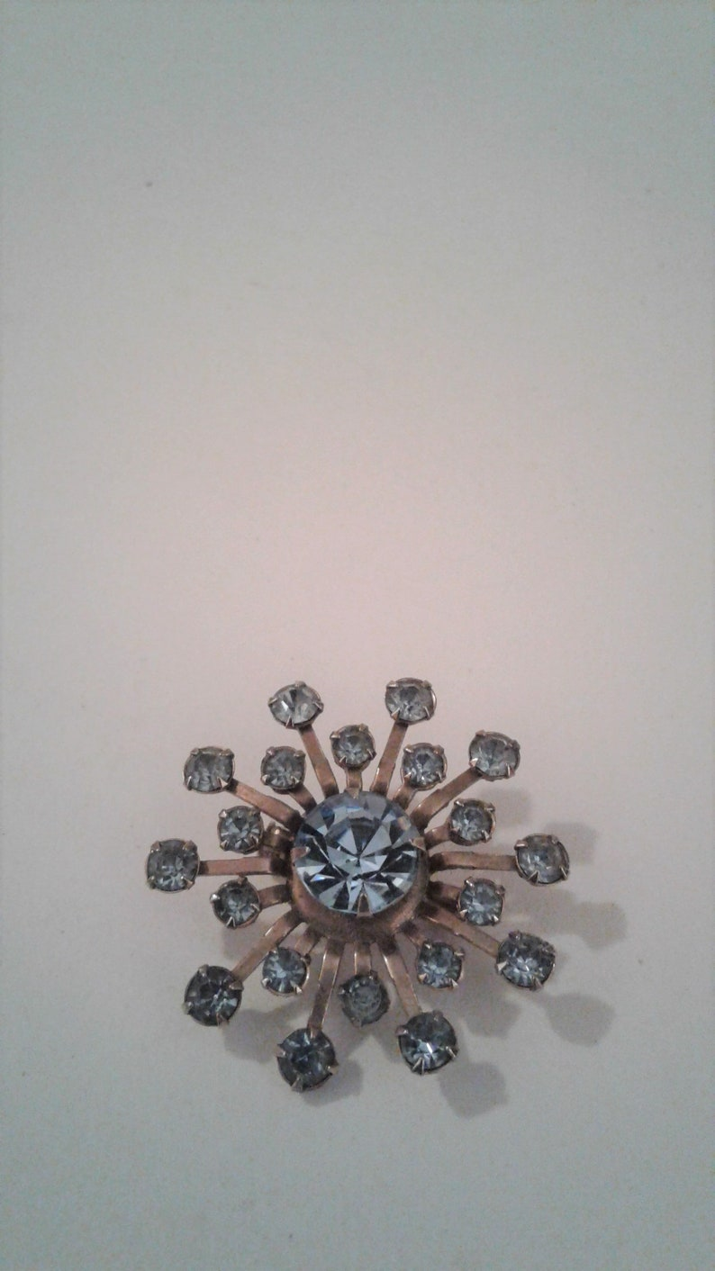 Vintage Pinwheel Flower Brooch Gold Tone And Blue Rhinestone Pin
