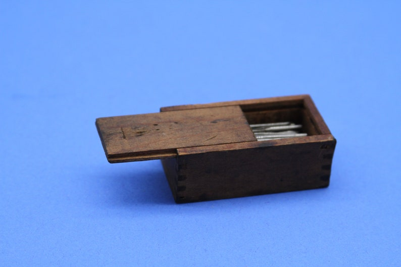 Vintage miniature wooden dovetail box with sliding lid  and sewing needles