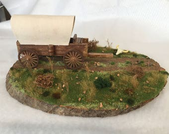 Diorama of covered wagon on the prairie