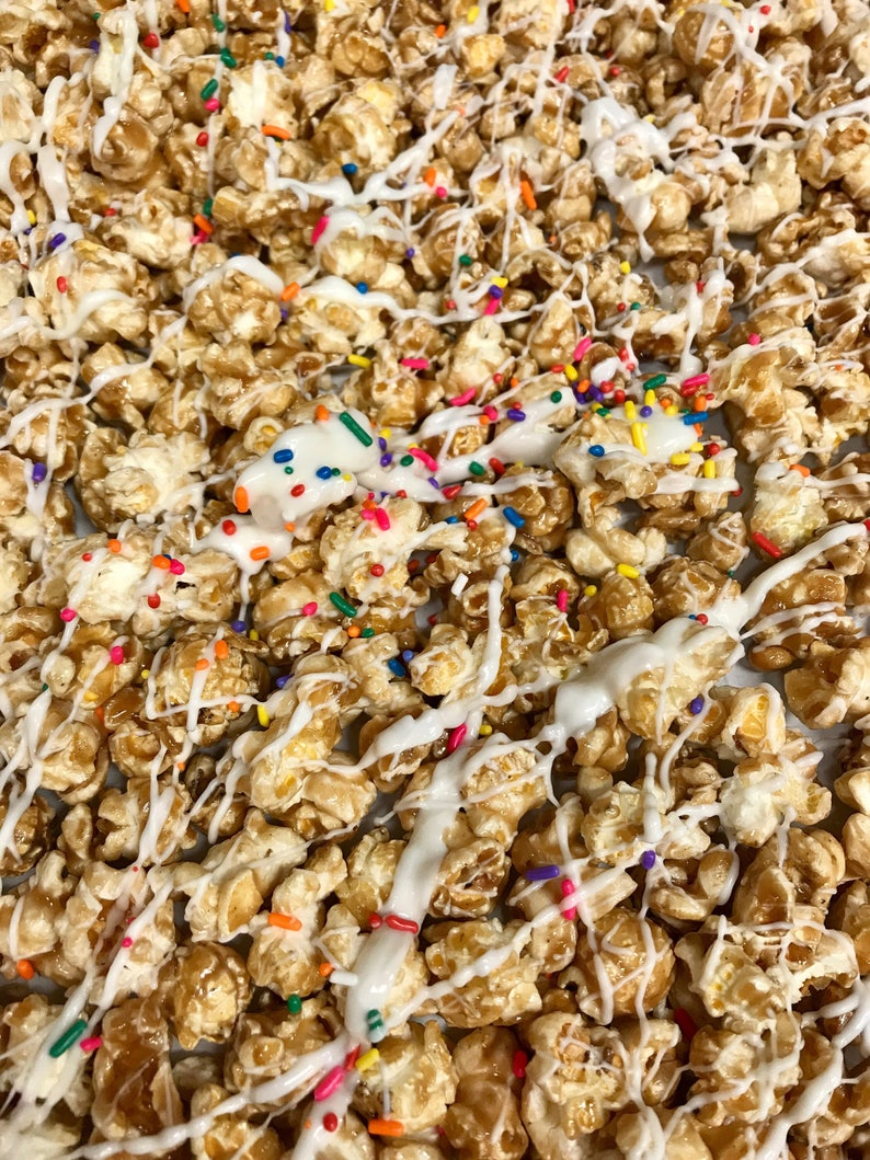 Birthday Cake Popcorn With White Chocolate Icing And Sprinkles