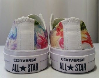 e2d700bae733 Floral and White Chuck Taylor