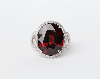 The Adar - 18K Handcrafted White Gold Oval Shaped Spessartite Garnet Unique Halo Round Brilliant Diamonds Engagement Ring