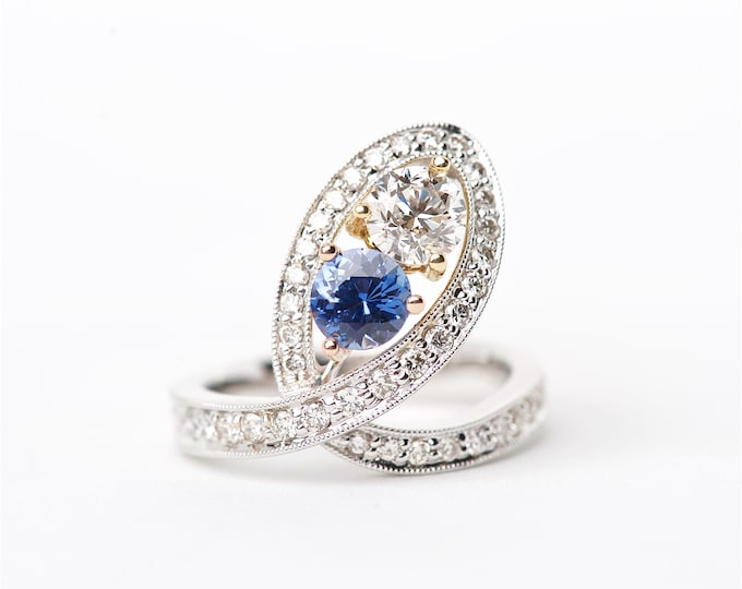 The Mercedes - 18K Handcrafted White Gold One Round Cut Diamond One Round Cut Sapphire Unique Halo Round Brilliant Diamonds Engagement Ring