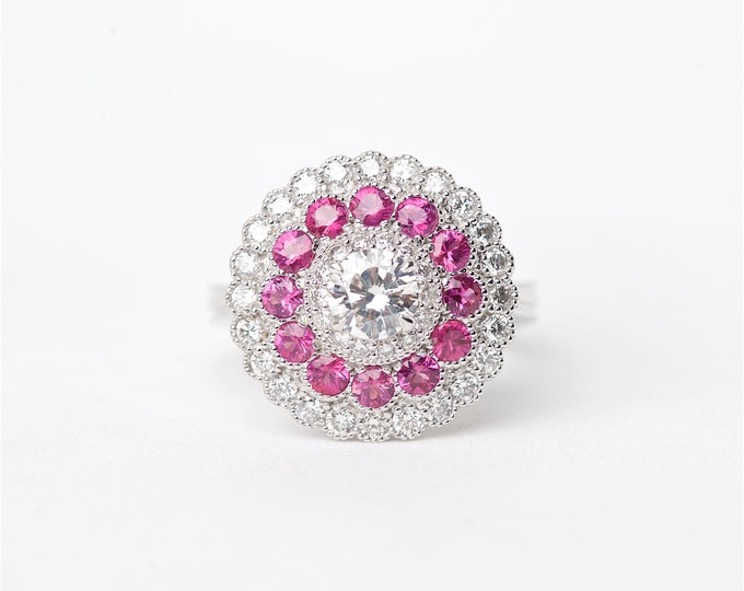 The Petunia - 18K Handcrafted White Gold Round Shaped GIA Certified Center Diamond Stone Surrounding Round Diamonds and Pink Sapphires