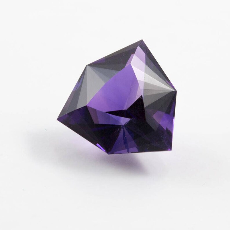 faceted in America. 7.40 carat Amethyst trilliant gemstone from Uruguay
