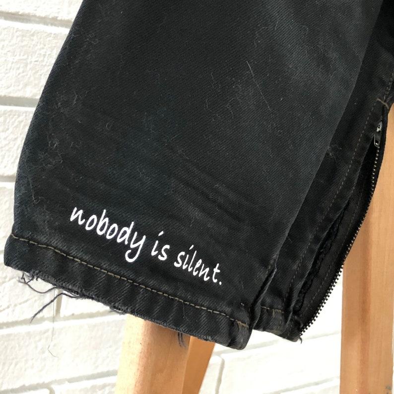Distressed Ripped Black Denim Capris Nobody is silent. image 0