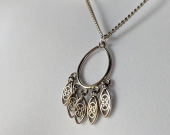 Five Dangling Drops Necklace on a silver curb chain