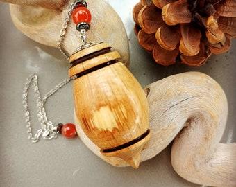 Warmed holm oak wood pendulum