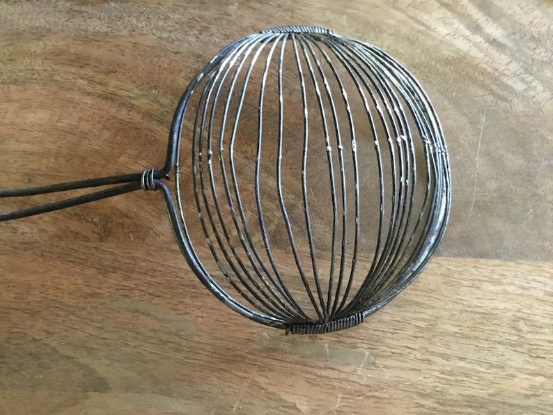 Pair Primitive handled Metal Egg separater strainers