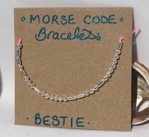 Handmade MORSE-Code bracelet. Bestie. Fully adjustable. Silver plated beads on hot pink coloured beadalon thread SRA J57