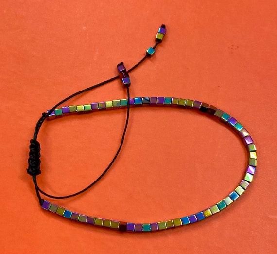 Friendship bracelet fully adjustable 2mm rainbow hematite cube bead bracelet on black coloured beadalon thread SRA J57 stacking