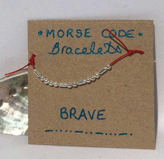 Handmade MORSE-Code bracelet. Brave. Fully adjustable. Silver plated beads on red coloured beadalon thread SRA J57