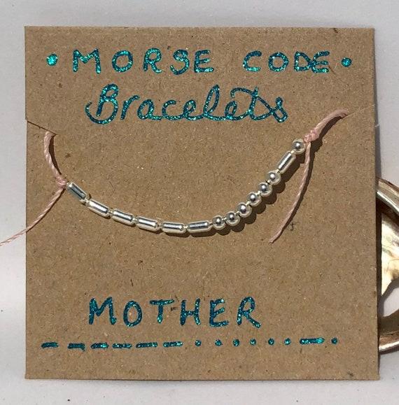 Handmade MORSE-Code bracelet. Mother. Fully adjustable. Silver plated beads on pink coloured beadalon thread SRA J57
