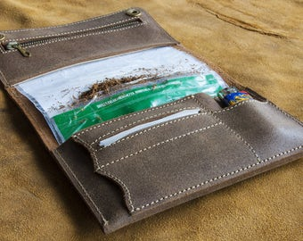 Leather heel case with filter pocket, a tobacco pocket and one for maps and lighter
