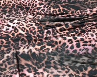 Cheetah fabric jersey. Stretch jersey fabric. Pink cheetah fabric jersey. Leopard fabric stretch. Pink leopard jersey fabric.