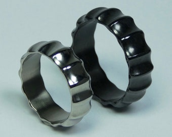 "SET of black polished zirconium ring ""Ammonite"" and polished titanium ring ""Ammonite"". Zirconium and titanium hand crafted pair of rings."