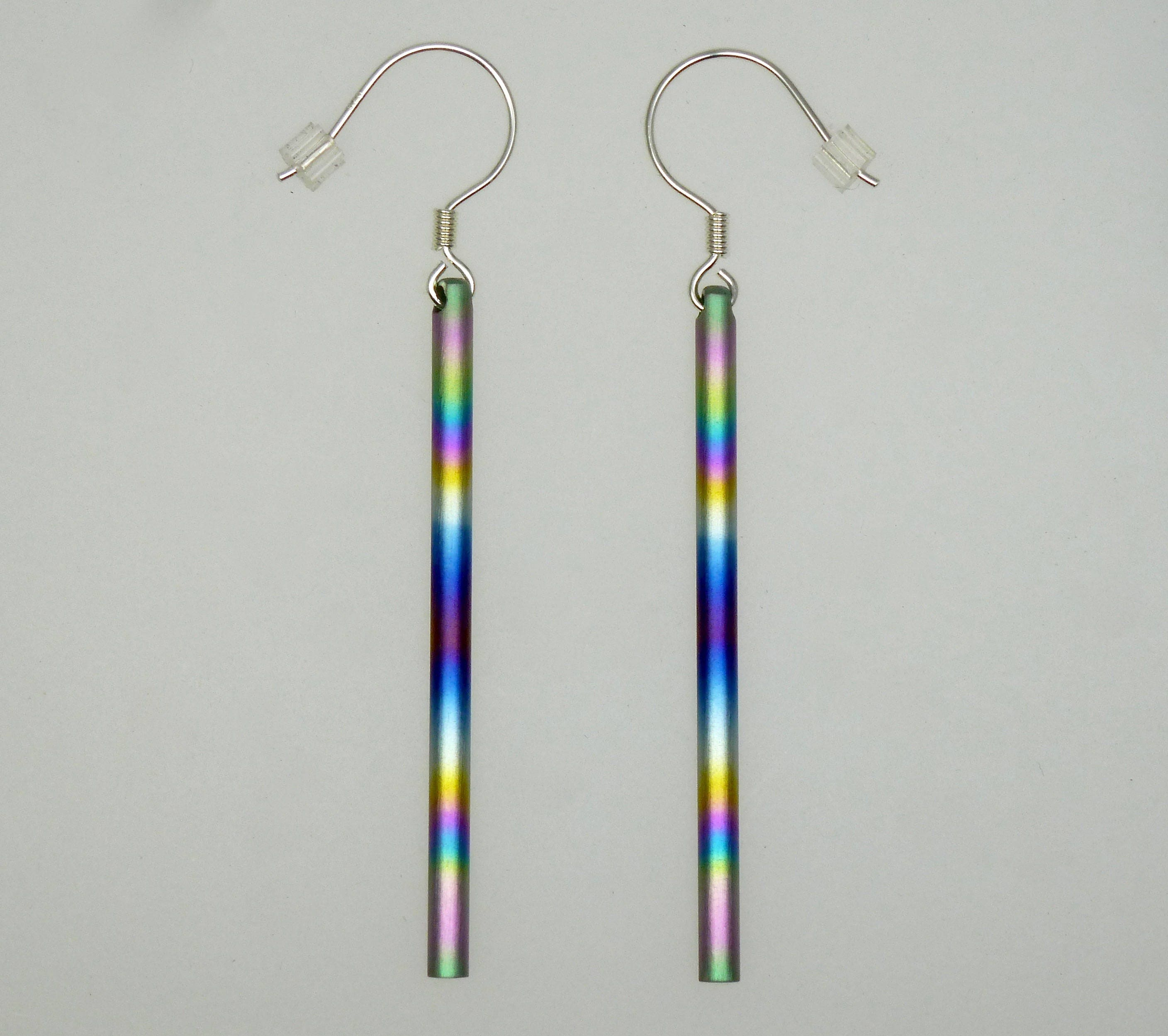 Anodized titanium long dangle round bar 3mm thick and 50 mm in length   Anodized titanium and silver pair of earrings