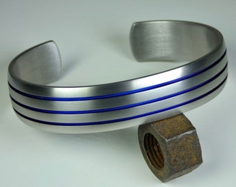 Domed hand crafted grade 2 titanium cuff bracelet anodized grooves. Mens bracelet. Mens jewellery.