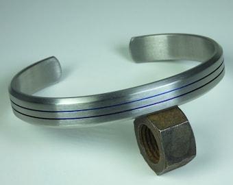 Solid grade 2 titanium hand crafted bracelet anodized grooves. Mens bracelet.