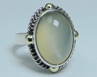 Silver 925 and 14 carat gold and moonstone ring.