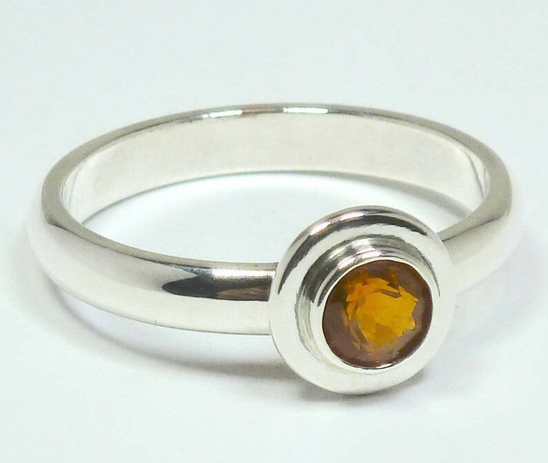 Fire opal silver ladies ring Facetted round fire opal and silver 925 ladies ring Fire opal from Mexico hand crafted ladies ring.