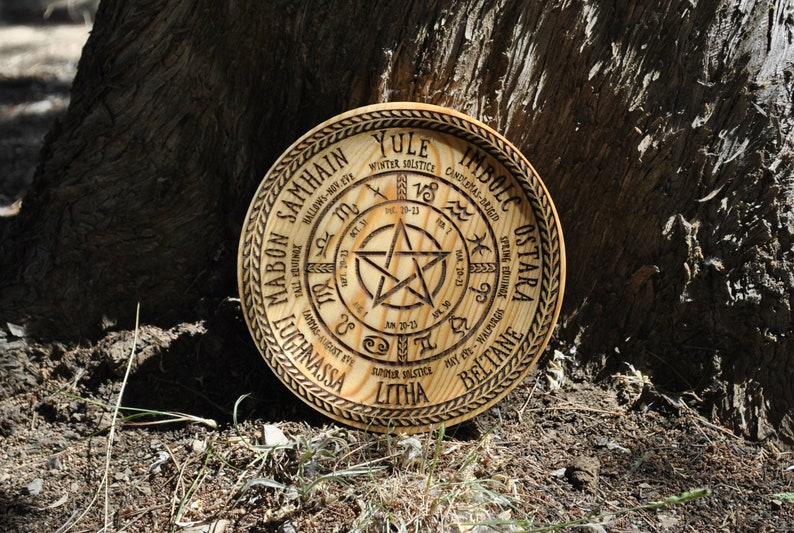 Wheel of the year Wicca and staff engraved on pine wood plate. image 0