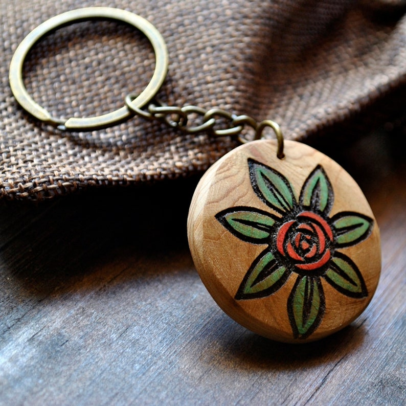 Pyro-etched juniper wood keychain with flower and painted. image 0