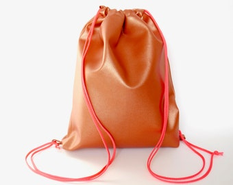 Backpack copper metallic, faux leather, neon pink lining, from favorite cuts