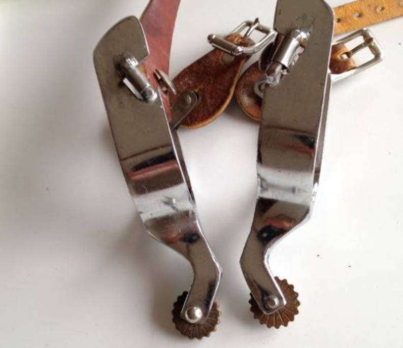 cowboy cowgirl rodeo Vintage heavy chrome over steel spurs with North /& Judd spur strap buckles shiny chrome in great shape brass rowels