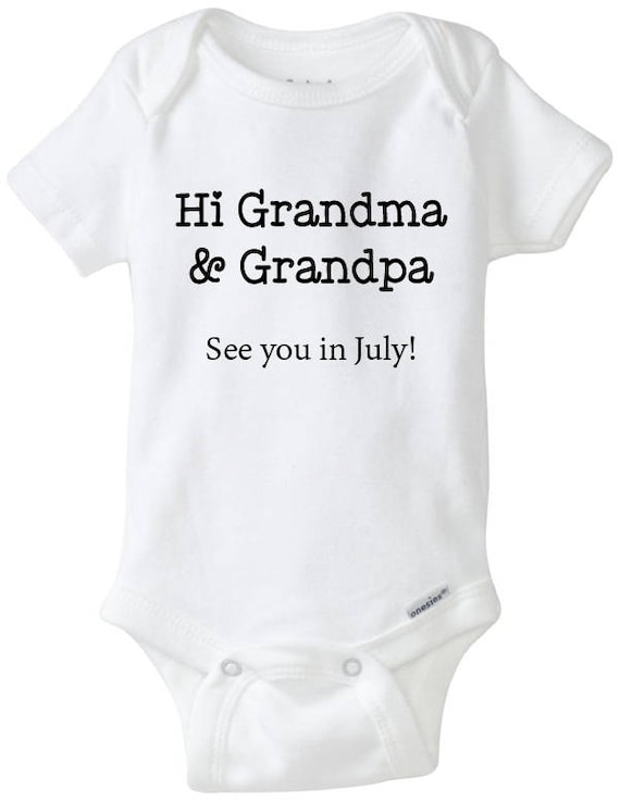 Pregnancy reveal to Nanny and Grandad white baby grow with gold glitter writing.