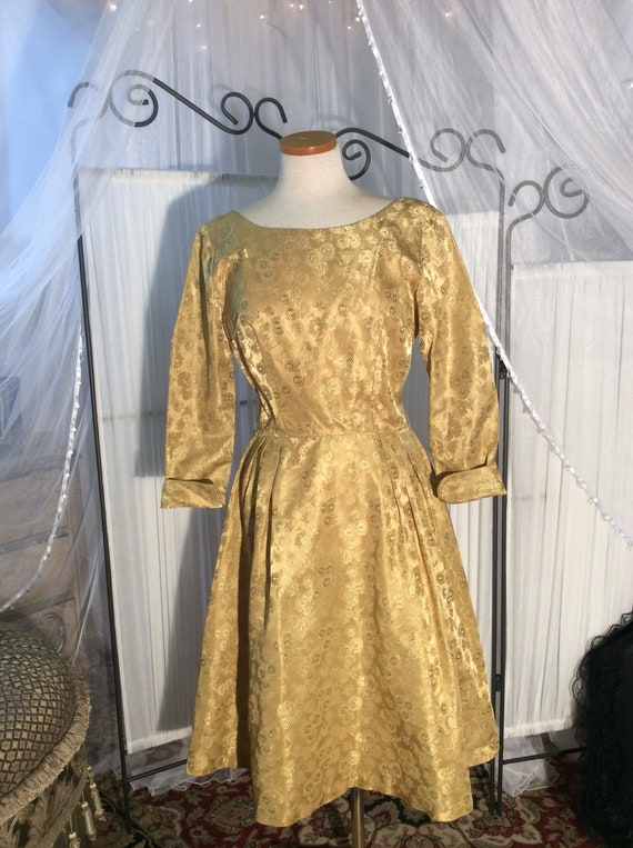 1960's festive gold brocade party dress knee length with long sleeves