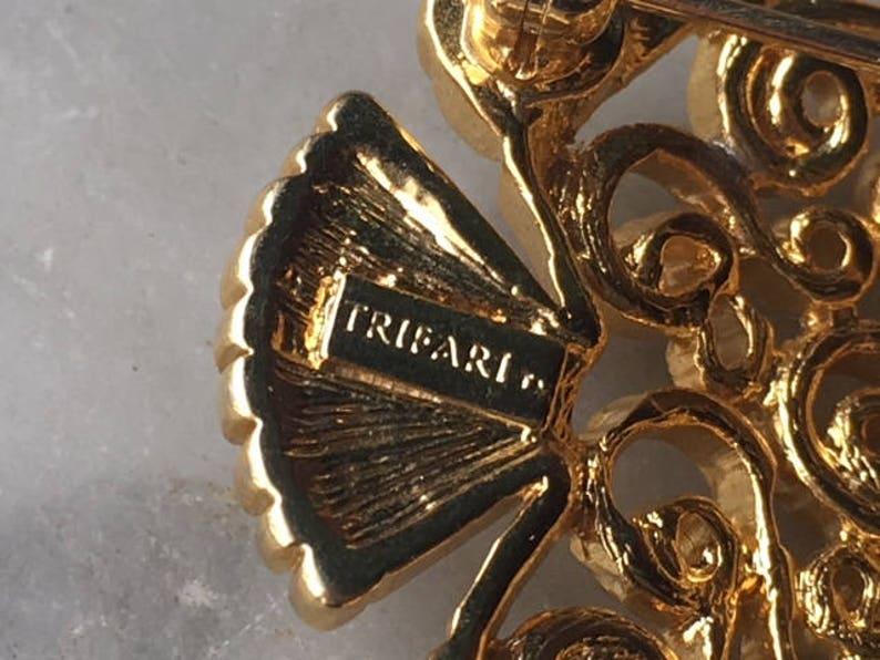 Vintage Trifari Figural Angel Fish Brooch Pin Gold Tone Rhinestone Eye Openwork Scroll Swirl Tropical Undersea Marine Animal Costume Jewelry