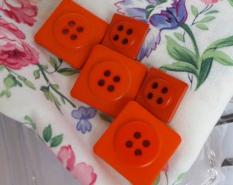 Assortment of Red Plastic Square Buttons