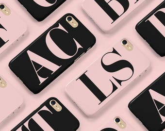 Large initial phone case with pink letters and a black background. A phone case for iPhone and Samsung Galaxy devices.
